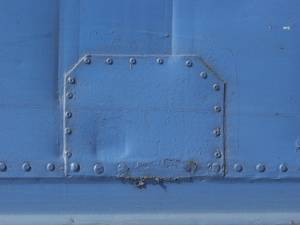 blue-painted-metal-plate-studded-with-bolts_300x300.jpg